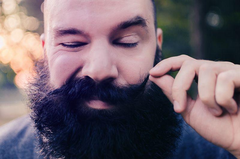 Man using moustache wax